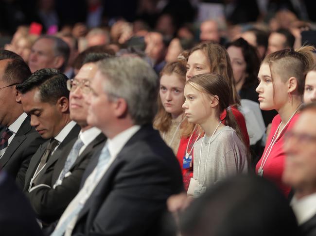 Swedish environmental activist Greta Thunberg listen in to President Trump. Picture: AP Photo/Markus Schreiber.