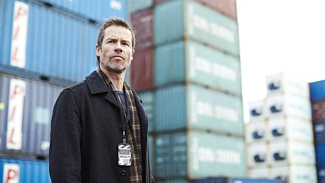 Action man ... Guy Pearce in the role of Jack Irish bumps heads with a shipping boss. Picture: ABC