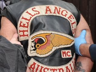 A Hells Angels member is arrested. Picture: AAP/Julian Smith