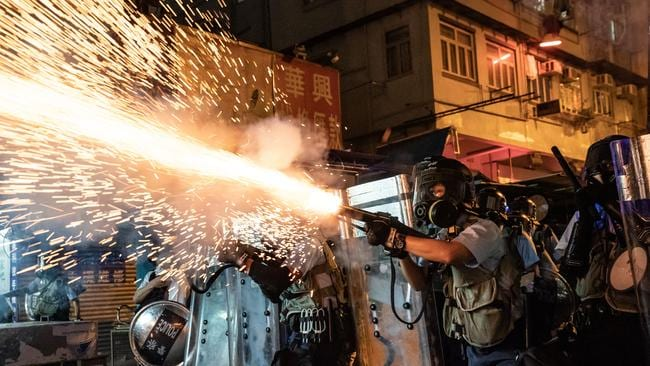 Police fire tear gas to clear pro-Democracy protesters during a demonstration on Hungry Ghost Festival day in the Sham Shui Po district on August 14, 2019 in Hong Kong, China. Picture: Anthony Kwan/Getty Images