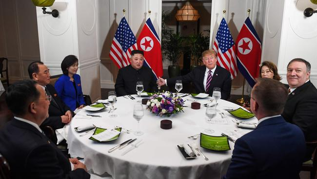 US President Donald Trump and North Korea's leader Kim Jong Un sit with others for a dinner at the Sofitel Legend Metropole hotel in Hanoi. Picture: Saul LOEB / AFP