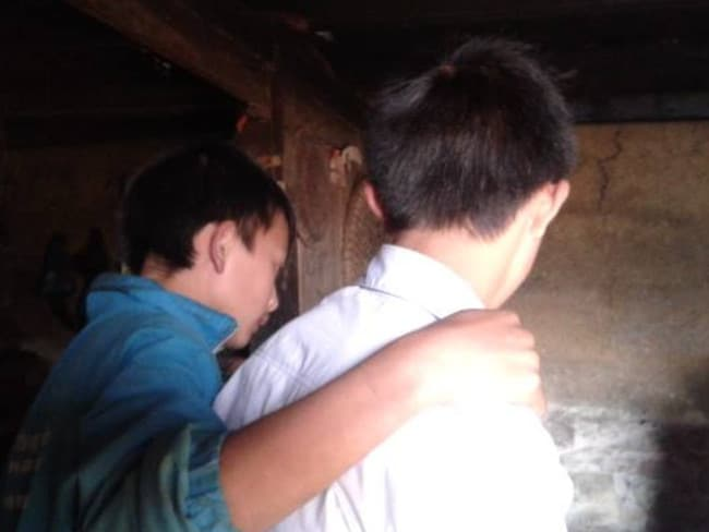 Sung, 16, is reunited with his family after wandering through China alone. Picture: Blue Dragon
