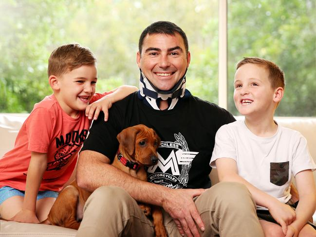 Brad Lewis with his sons Oscar, 8, and Connor, 6, and dog Marley. Brad is nominated for a Pride of Australia Medal. Picture: Tim Hunter