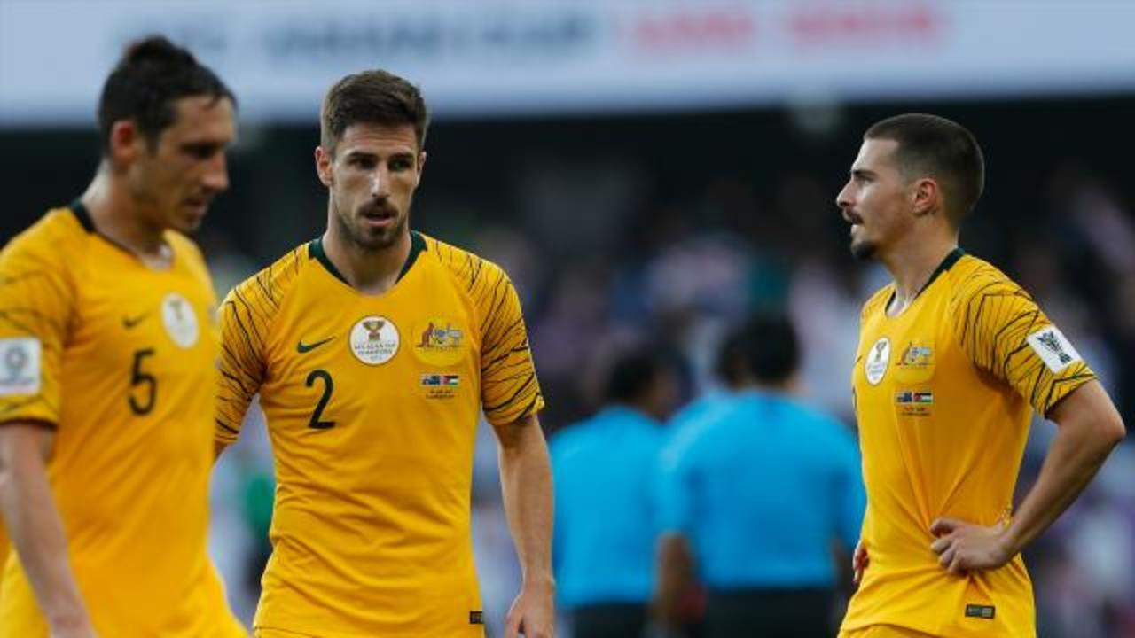 Roos lose Asian Cup opener