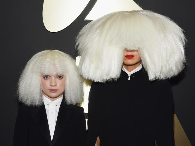 Sia and dancer Maddie Ziegler wearing matching white wigs at the Grammys.