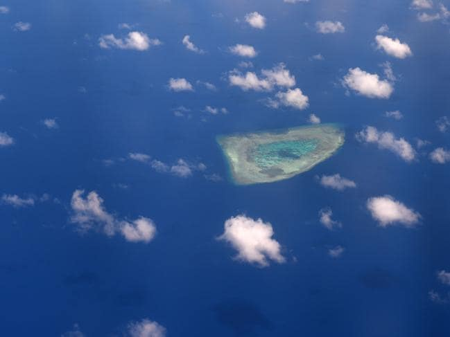 An aerial view of a reef in the disputed Spratly Islands in the South China Sea. Picture: Ted ALJIBE / AFP
