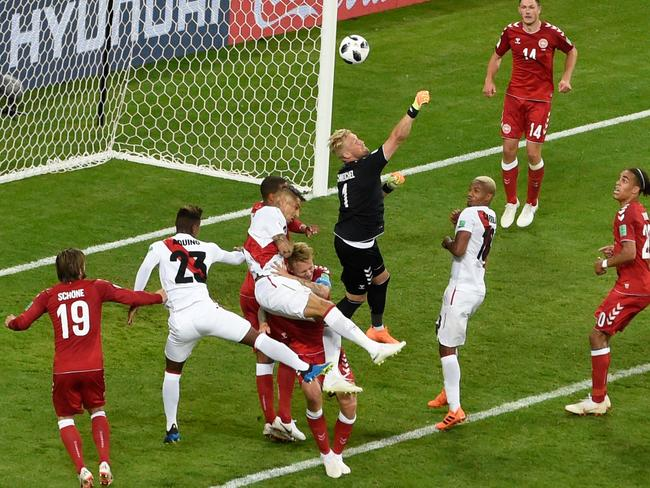 Denmark's goalkeeper Kasper Schmeichel (C) comes out to punch the ball from a corner