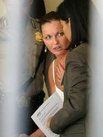 SCHAPELLE CORBY'S LIFE BEHIND BARS - 2004 - Australian tourist Schapelle Corby with lawyer at police headquarters in Denpasar for hearing after being arrested when Customs officials seized 4.1kg of marijuana from her luggage on her arrival in Bali. Picture: Lukman S Bintoro