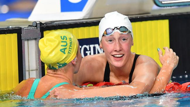 Taylor Ruck hugs Ariarne Titmus after touching her out by 0.04 of a second. Picture: AAP Image/Darren England