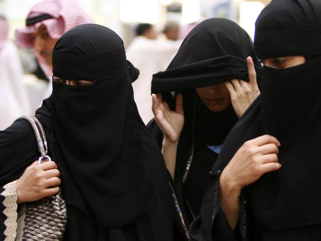Women in Saudi Arabia are expected to cover from head to toe when in public. Picture: Hassan Ammar/AP