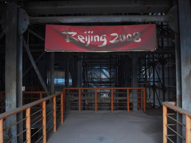 A faded Beijing 2008 sign sits in the grandstand of the beach volleyball stadium.
