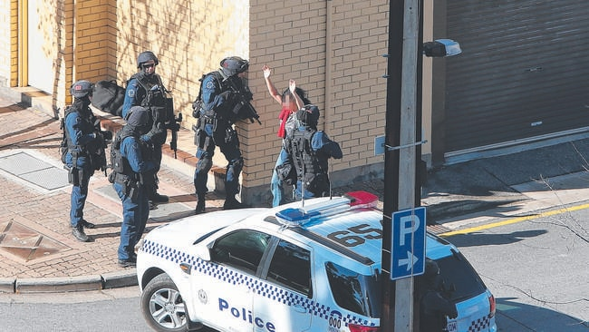 The second of four women held during yesterday's seige is released. Picture: Tait Schmaal.