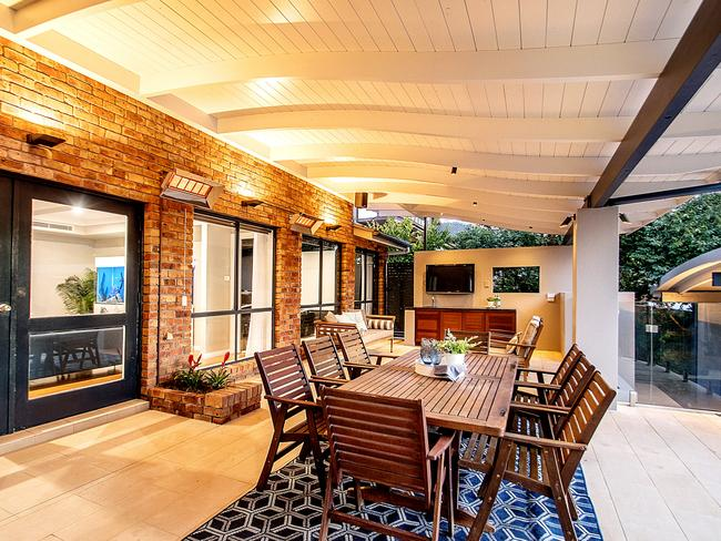 The outdoor terrace features heaters, a television and barbecue area.