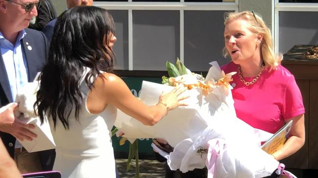 Meghan seemed 'genuinely excited and flattered' to receive the flowers.