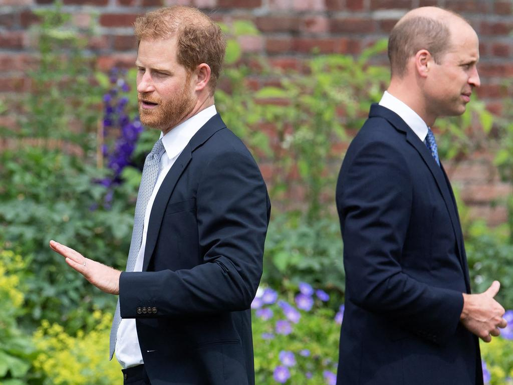 Britain's Prince Harry, Duke of Sussex (L) and Britain's Prince William, Duke of Cambridge attend the unveiling of a statue of their mother, Princess Diana at The Sunken Garden in Kensington Palace.