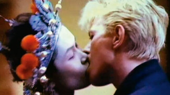 Close couple ... David Bowie pashes Geeling Ng in the China Girl video