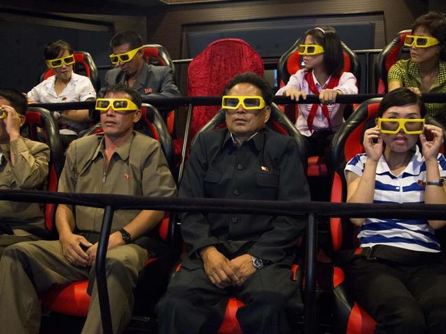 North Koreans test out 3D glasses as they prepare to watch a 3D movie on an amusement park ride at the People's Pleasure Park in Pyongyang. Picture: David Guttenfelder/AP