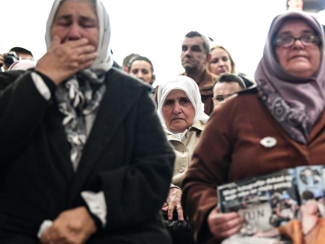 People watch a live TV broadcast of the verdict in Srebrenica.
