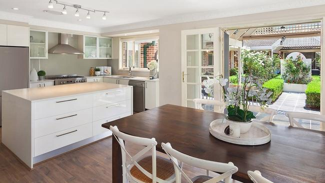 Open-plan kitchen with French doors spilling open to the gardens.