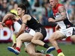 Round 18: Jack Viney gets caught by Port's Chad Wingard . Picture: Sarah Reed.