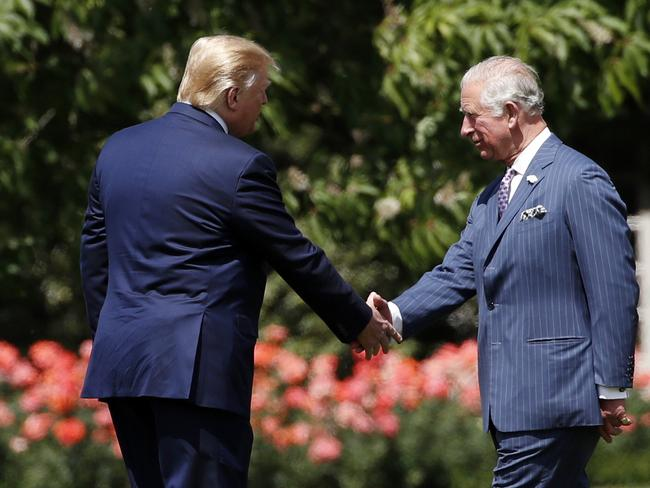 Prince Charles was the first to meet the President when he arrived on Marine One, in a break from royal protocol. Picture: AP Photo/Alex Brandon.