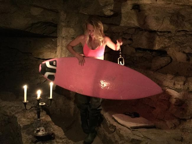 The Hawaiian surfer brought her bright pink surfboard along for the ride. Picture: Caters News Agency