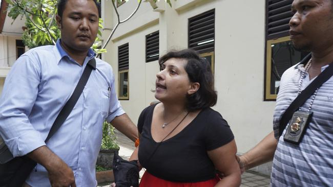 Taqaddas is escorted by investigators after her trial in Bali. She was sentenced on Wednesday to six months in prison. Picture: AP