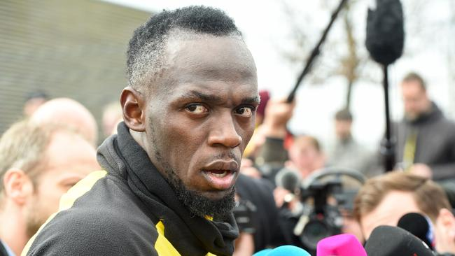 Retired Jamaican Olympic and World champion sprinter Usain Bolt answers journalists