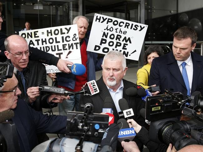 Child abuse advocate Peter Gogarty with media and protesters outside Newcastle Court this week. Picture: Darren Pateman.