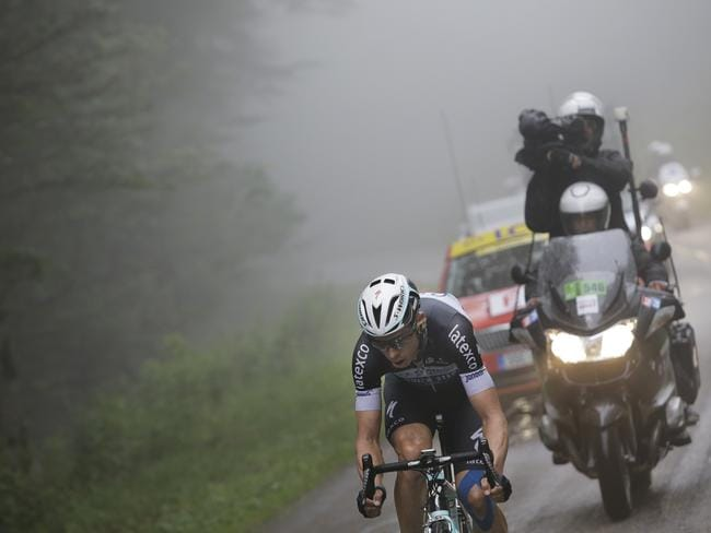 Stage winner Germany's Tony Martin rides in the fog.