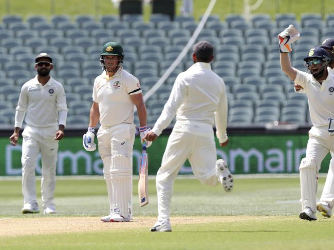 Indian players celebrate the dismissal of Australia's Aaron Finch, second left, on day four during the first cricket test between Australia and India in Adelaide, Australia,Sunday, Dec. 9, 2018. (AP Photo/James Elsby)
