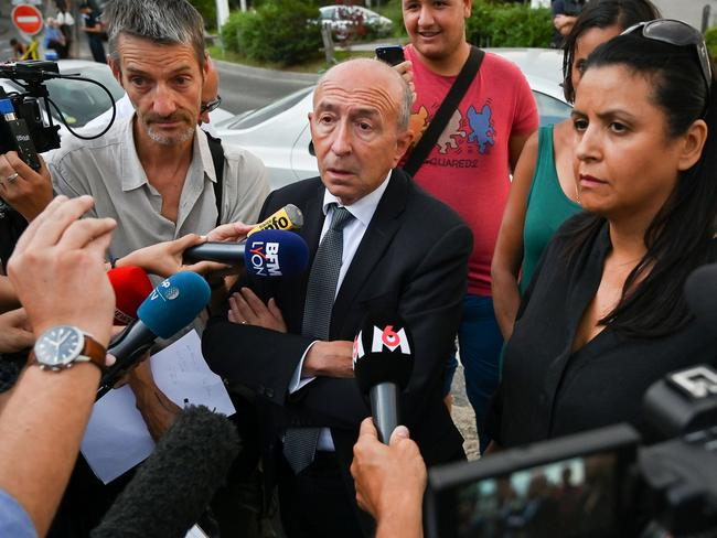 Mayor of Lyon Gerard Collomb (C) talks to the press in Villeurbanne on the outskirts of Lyon, southeastern France. Picture: AFP