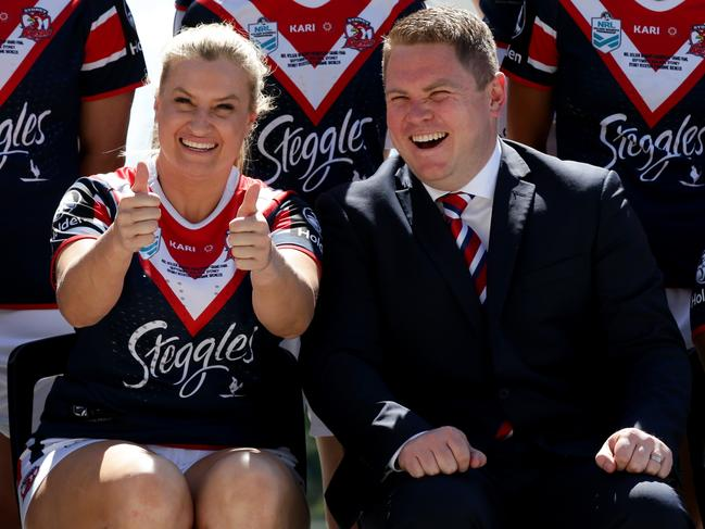 Sims and coach Adam Hartigan having a laugh as they get their official team photo. Pic: Jonathan Ng