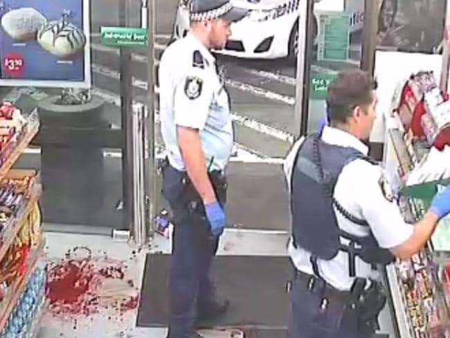 Blood on the floor as police investigate the aftermath of the axe attack in 2017.