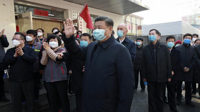 People clapped behind him as he wave during the appearance. Picture: AP/Xinhua/Pang Xinglei