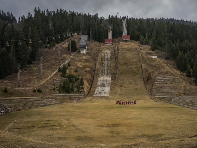 Children gather at foot of the 1984 Olympic Ski jump hill at Igman just 25km from downtown Sarajevo. The area around the 90m hill was heavily mined during the Bosnian war just 8 years after the 1984 Winter Olympics.