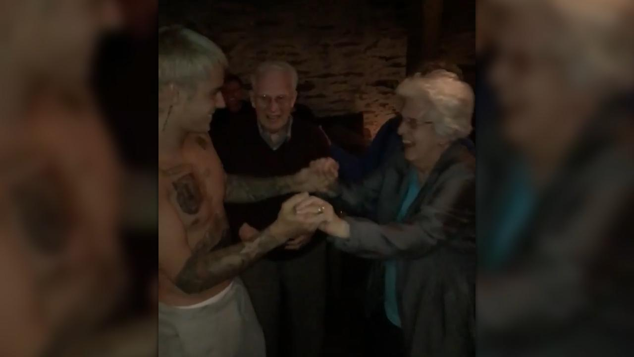 Justin Bieber dances with elderly woman in NZ
