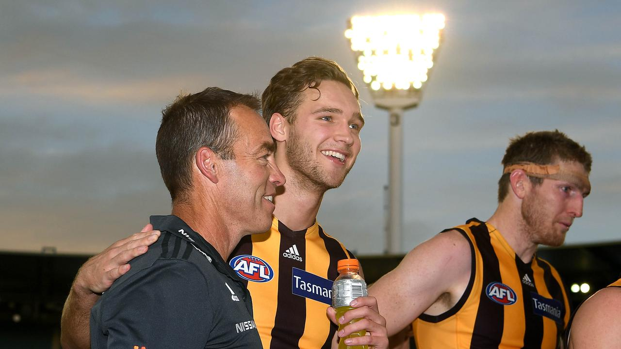 Alastair Clarkson and Jack Scrimshaw celebrate after beating North Melbourne in Round 3.