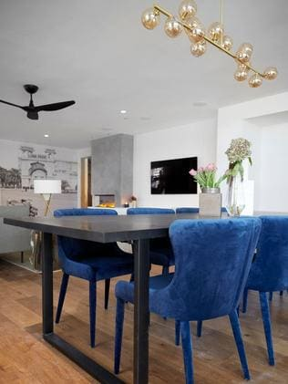 Popping electric blue dining chairs.