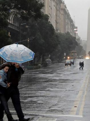 A couple cross a street in downtown Buenos Aires during a power cut. Picture: AFP