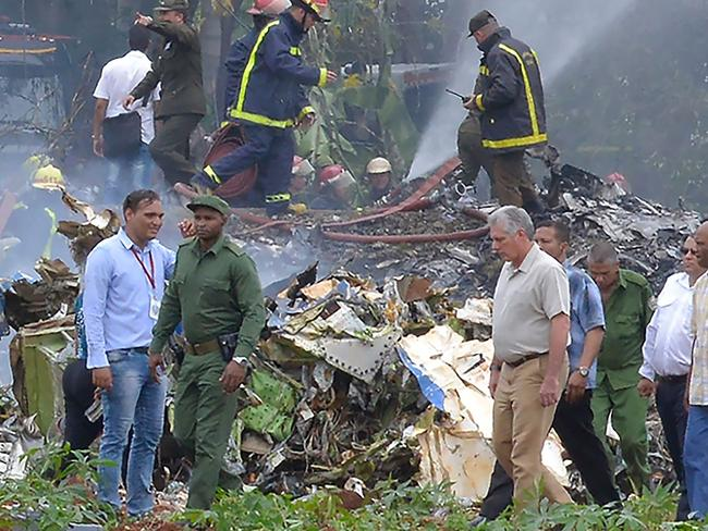 Cuban President Miguel Diaz-Canel (in khaki) is pictured at the site of the accident. Picture: AFP