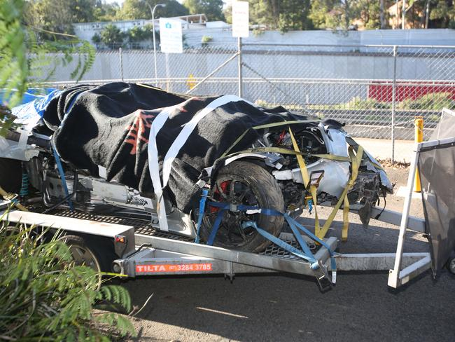 Grant Denyer's smashed rally car being trucked back to Sydney from Melbourne. Picture: Bob Barker.