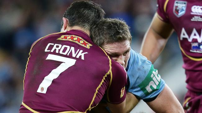Ryan Hoffman is tackled by Cooper Cronk.