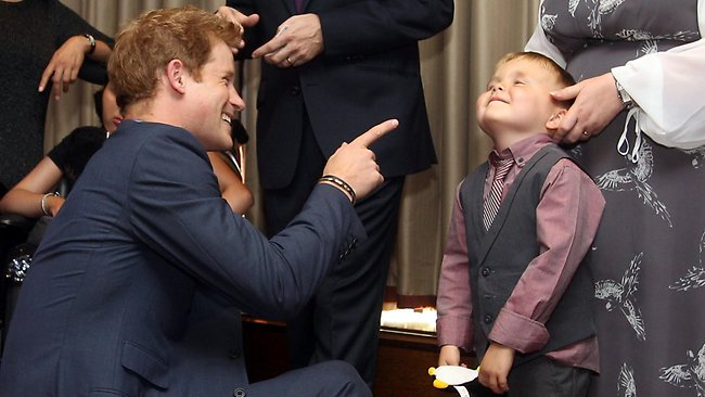 Prince Harry shares a laugh with Alex Logan at the WellChild Awards in London. Picture: