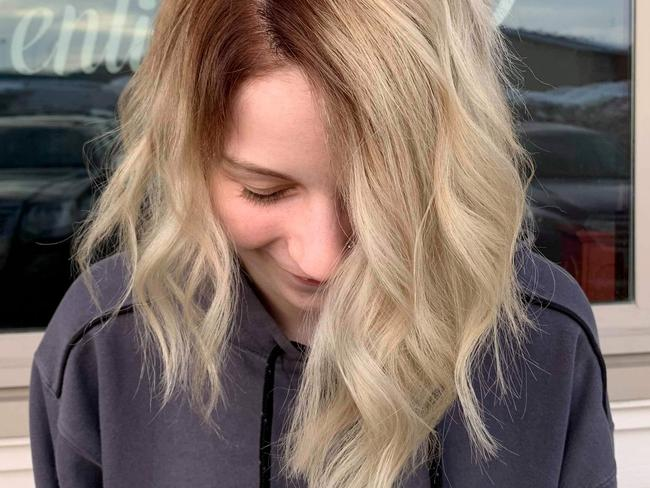 A kind hairdresser came to her rescue after the teen was labelled 'stupid' for attempting to go blonde at home. Picture: Caters News
