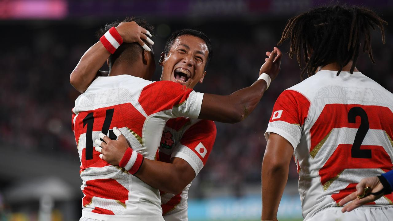 Japan's wing Kotaro Matsushima (L) is congratulated after scoring the first of three tries against Russia.
