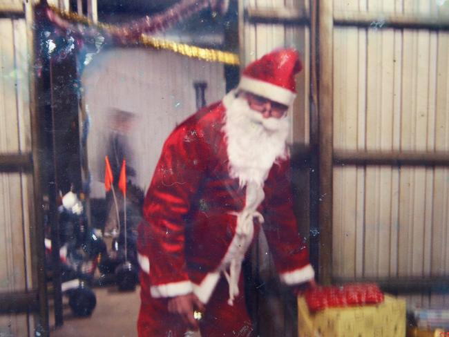 Charlie Colt dressed as Santa on the family farm at Boorowa where he said they were happy.