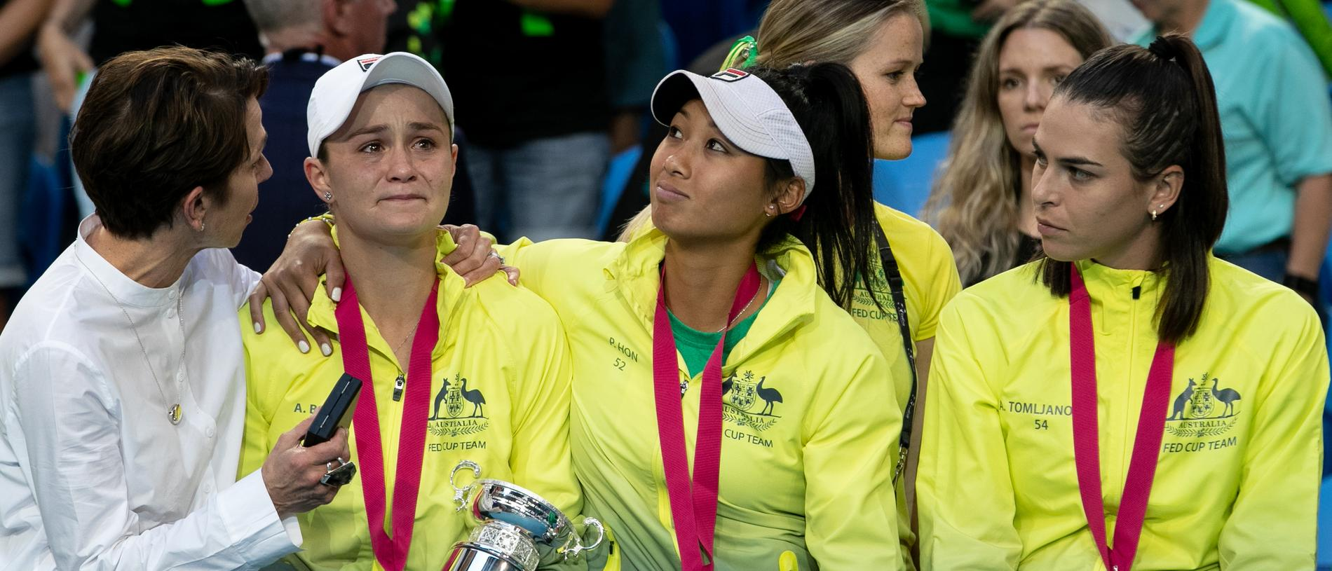 Ash Barty is comforted by Jayne Hrdlicka and Priscilla Hon and Ajla Tomljanovic at the Fed Cup Final tennis competition at RAC Arena in Perth, Sunday, November 10, 2019. (AAP Image/Fiona Hamilton) NO ARCHIVING, EDITORIAL USE ONLY