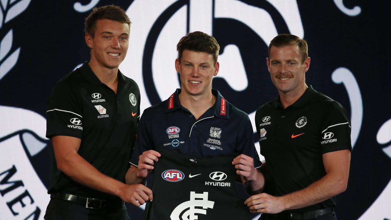 Carlton took Sam Walsh at Pick 1, with co-captains Patrick Cripps and Sam Docherty presenting his jumper. Picture: Michael Klein