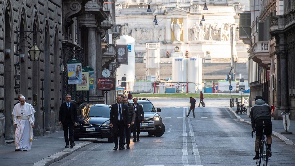 Pope Francis walks the empty Via del Corso in Rome on March 15. Picture: AFP Photo/Vatican Media